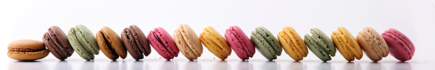 Wall Mural - Sweet and colourful french macaroons or macaron on white background, Dessert