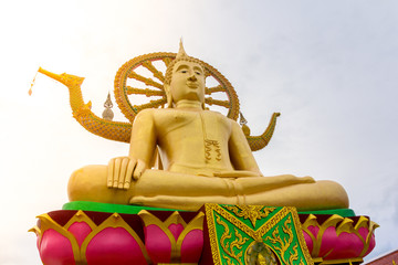 Big Buddha statue in gold color At Big Buddha Temple, Koh Samui, Thailand