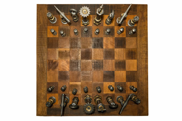 Unusual wooden chess board with forged iron pieces seen from above, isolated on white.