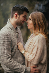 Young good looking couple being romantic embracing