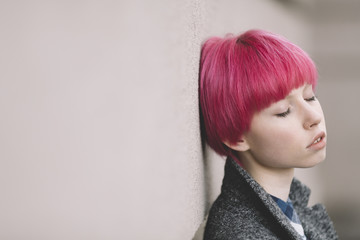 girl with pink hair .