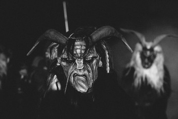 wooden hand carved scary masks from a krampus