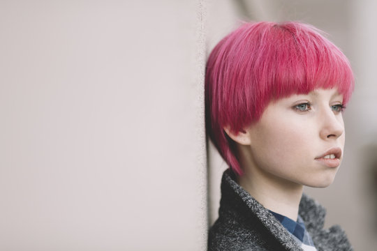 Portrait of girl with pink hair, selective focus .