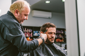 Barber Cutting Hair to a Client