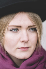 portrait of young woman with black hat, selective focus on eye