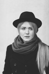 blond young woman with black hat