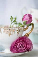 Ranunculus flowers in a vintage teacup