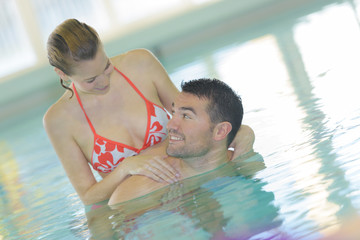 passionate young couple in swimming pool