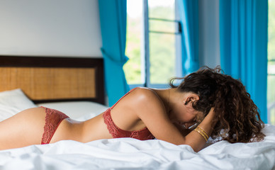 Attractive Young Woman Lying on the Bed
