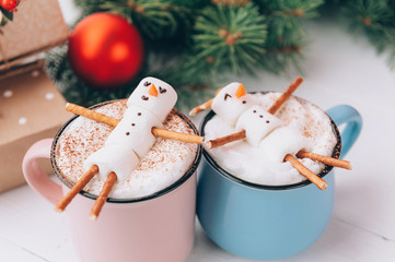mugs with hot chocolate in which the men from the zyphira relax. concept of a couple