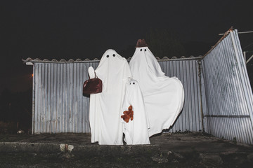 Happy family of ghosts