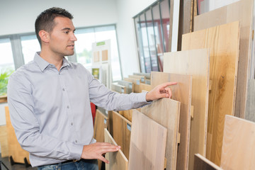 man chooses boards for home improvement
