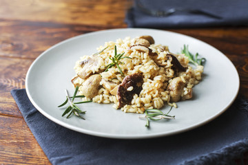 delicious rice with mushrooms and rosemary, risotto.