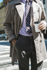 Businessman outfit details with coffee cup in hand