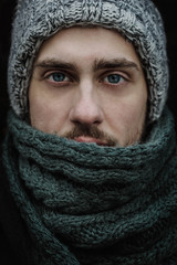 Close up of a beautiful male model in winter clothes