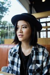 Portrait of a cute Asian girl looking away