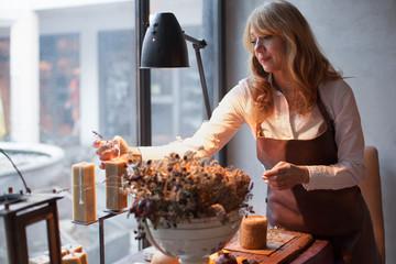 Senior businesswoman in her shop