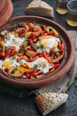 Food: Shakshuka with Bell Pepper, Onions and eggs in Tagine