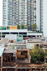 Contrast of Poor and Rich Buildings in Bangkok