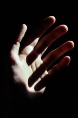 Hands in Harsh Light with Dark Shadow