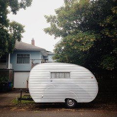 Silver Retro Camper in Front of House