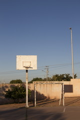 Basketball hoop and soccer goalpost in a sports playground