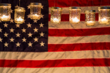 United States flag illuminated by candle light