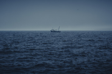 Sailing fishing boat in the middle of the sea