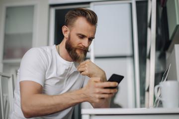 Interesting Looking Man Checking Phone