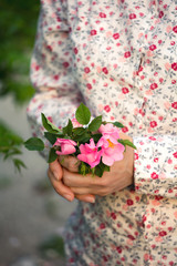 Woman holding a dog rose bouquet