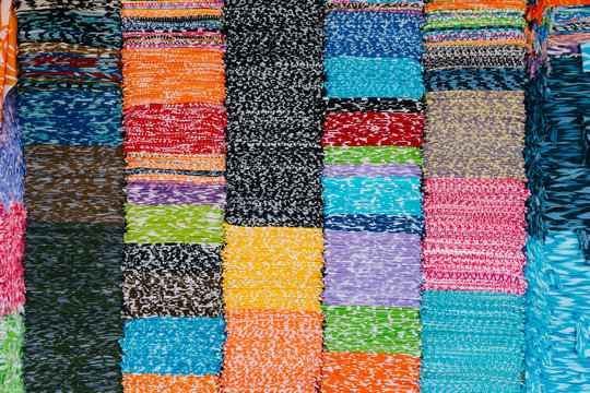 Stacks of Colourful Fabric in Wholesale Store in Bali