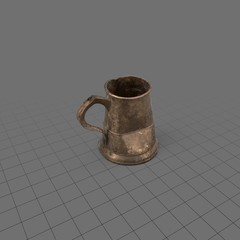 Dented pewter mug