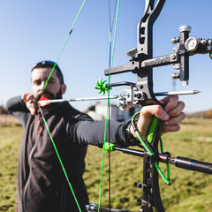 Male Archer Aiming with Professional Compound Bow