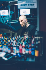 tattoo artist in his studio