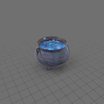Boiling liquid in metal cauldron