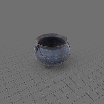 Empty metal cauldron