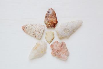 Native American arrowheads arranged like a flower