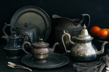 A set of pewter plates, platters, and pots.