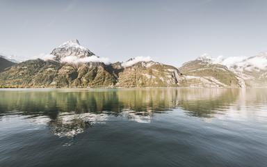 Autumn in the Alpine lake. Autumn gorgeous landscape in the Swiss Alps. Mountains reflected in Lake Lucerne.