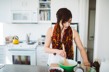 Young woman baking in her kitchen