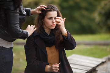 Assistant making model's hairstyle at the fashion shoot