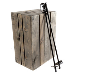 Ski poles resting on a crate