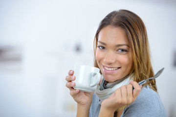 attractive female drinking tea from cup