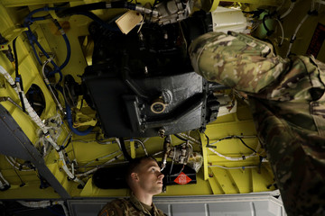 Soldiers from the 1st Armored Division, Combat Aviation Brigade, work to disassemble a CH-47 Chinook helicopter to ship to Puerto Rico in order to aid in recovery efforts following Hurricane Maria at Fort Bliss in El Paso, Texas