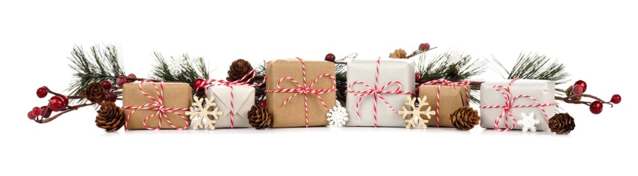 Christmas border with branches and rustic brown and white gift boxes isolated on a white background