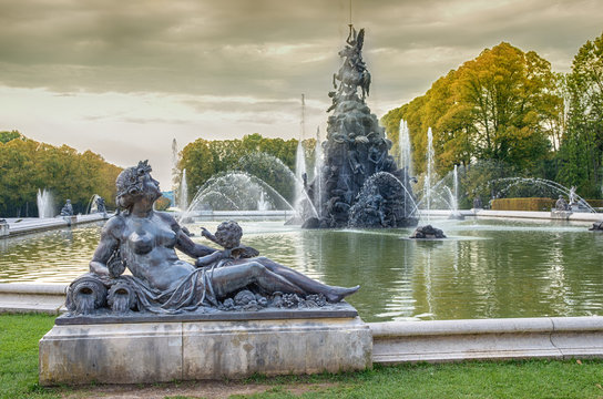 Fountain with water. Sculpture composition of baroque fountain in Man`s island, Chiemsee, Bavaria, Germany