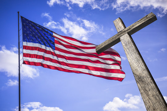American flag with a wooden cross