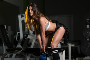 Healthy Young Woman Doing Exercise With Kettle Bell