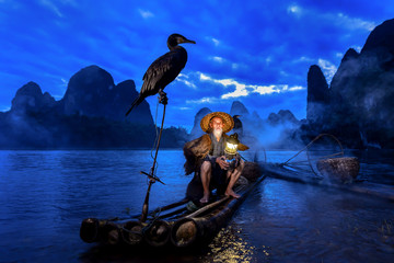 Fisherman of Guilin, Li River and Karst mountains, Guangxi, China