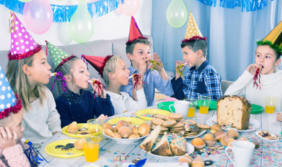 positive children having a good time at a birthday party